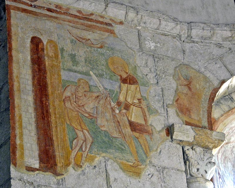 Martin of TOurs cuts his cloak to give to a beggar, depicted on the walls of the church of Saint Hilary, Poitiers.