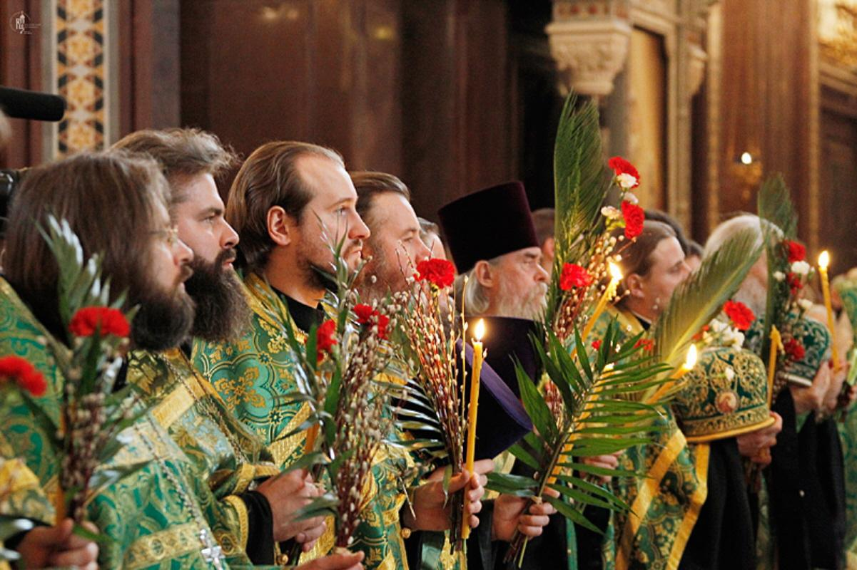 Palm Sunday in Moscow (2011); the clergy are holding festive bundles of palm fronds and pussy willows.