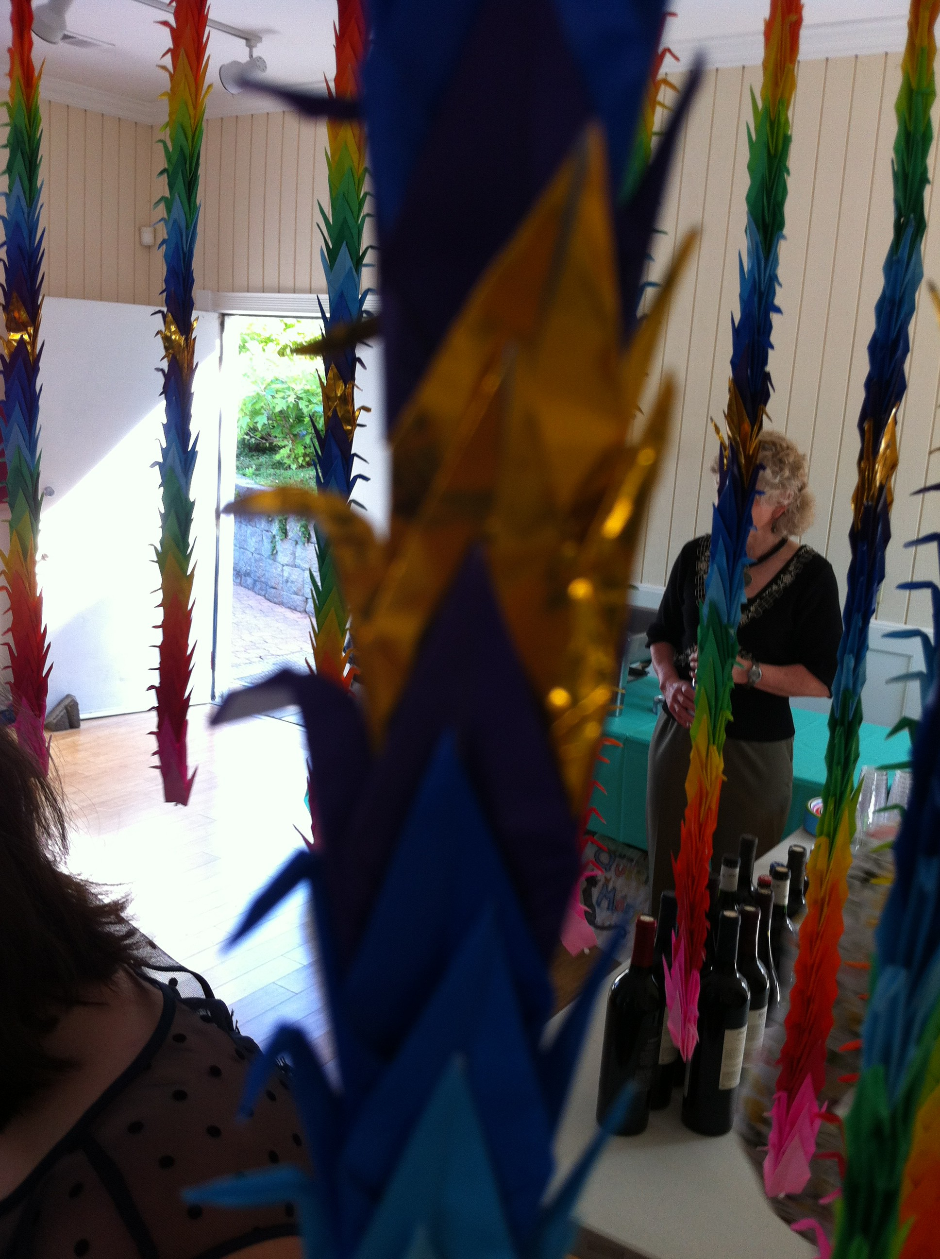 A close-up of the 1,000 origami cranes my niece and her new husband folded for their wedding.