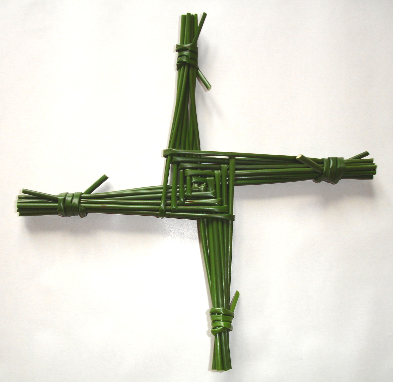 Legend says that while St. Brigit sat alongside a dying man one night, she picked up a handful of rushes from the floor and wove a cross, explaining the Gospel to the dying man as she made the cross. Nowadays many make similar crosses and hang them up to protect their house or barn until the next February.