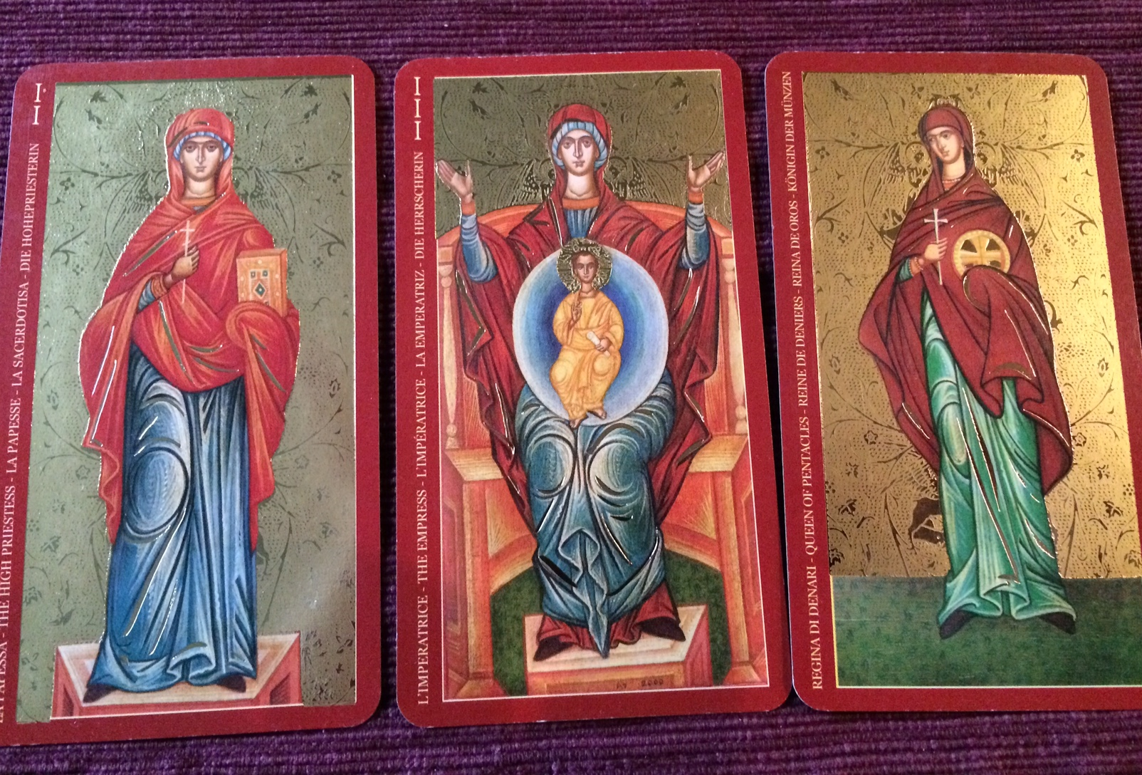 """The Golden Tarot of the Tsar"" (by A.A.. Atanassov and available thru Lo Scarabeo) depicts the Mother of God as the Empress, St. Parasceva as the High Priestess, and an anonymous woman martyr as the Queen of Pentacles."